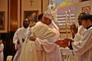 09-bishop-wens-welcomes-the-newly-ordained-father-enkhe